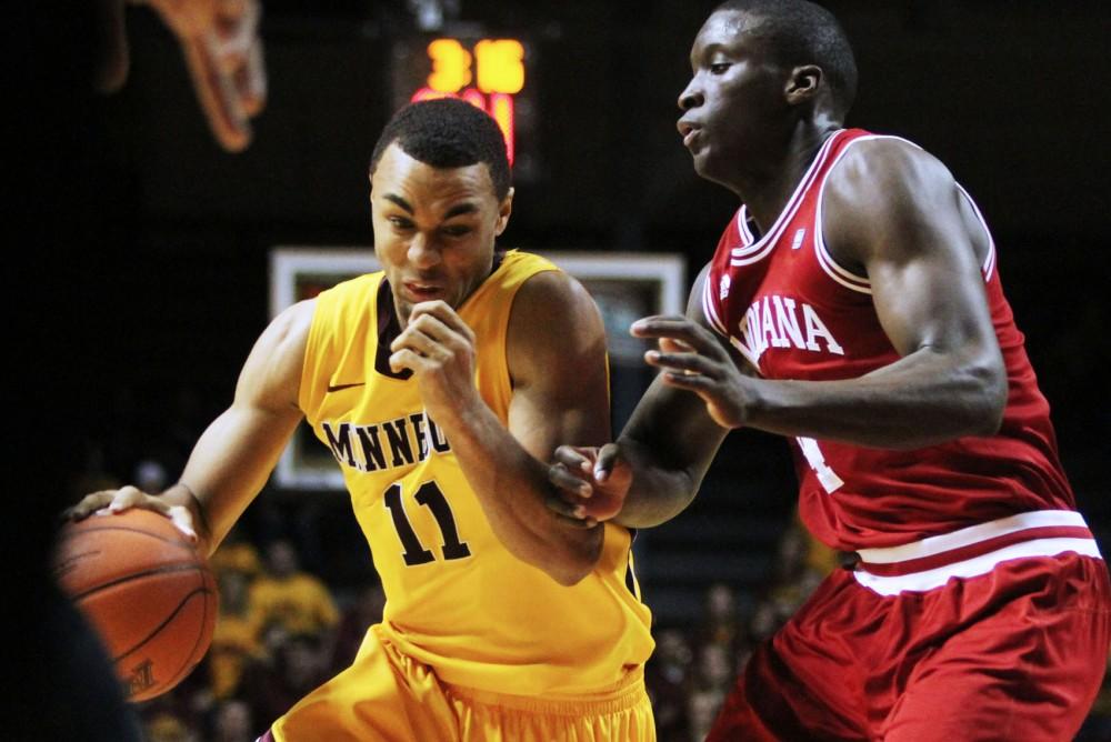 Minnesota guard Joe Coleman tries to drive past Indiana guard Victor Oladipo on Sunday at Williams Arena. Indiana defeated Minnesota 69-50.