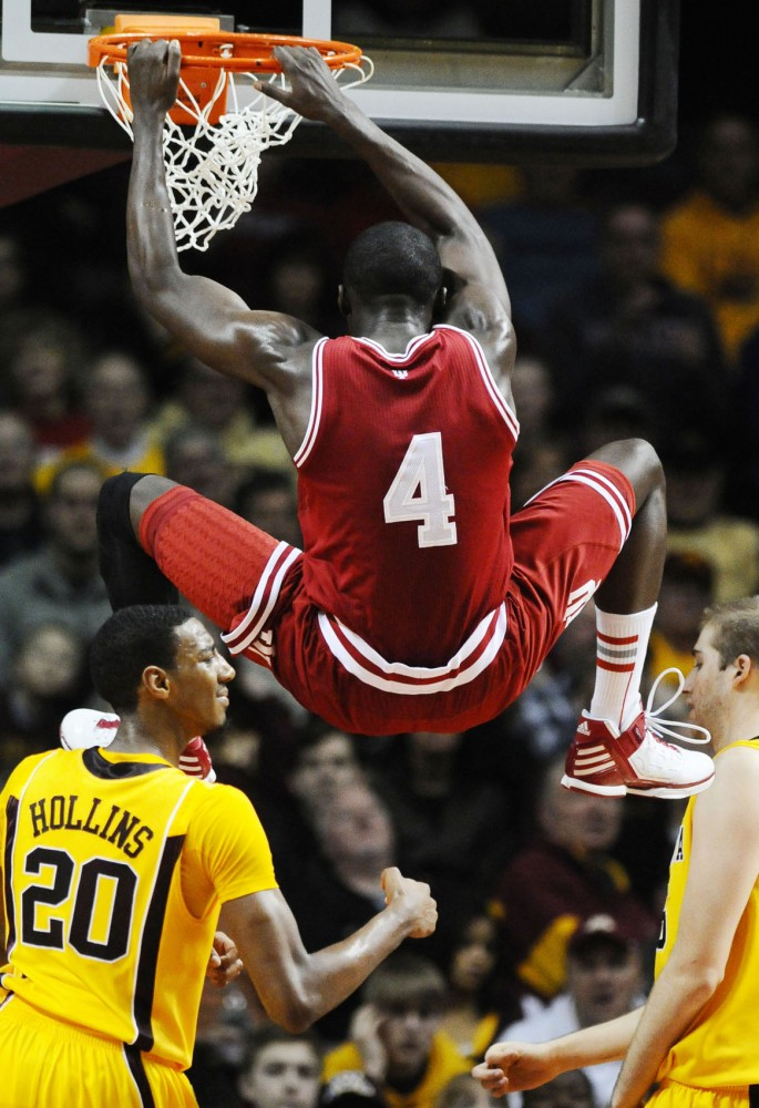 Indiana guard Victor Oladipo dangles from the hoop during Sundays game hosted by Minnesota at Williams Arena. Oladipo scored 12 of Indianas 69 points, while Minnesota finished with 50.