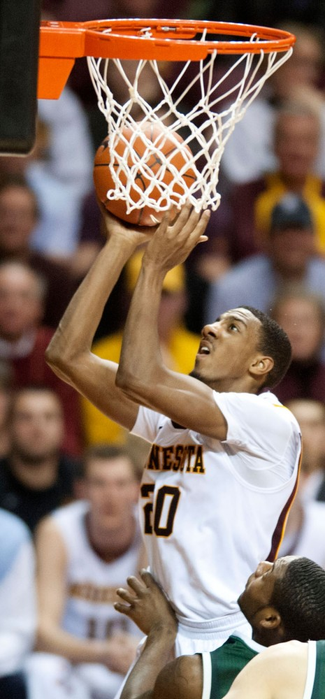 Minnesota guard Austin Hollins attempts a basket during a game against Michigan State on Wednesday at Williams Arena.