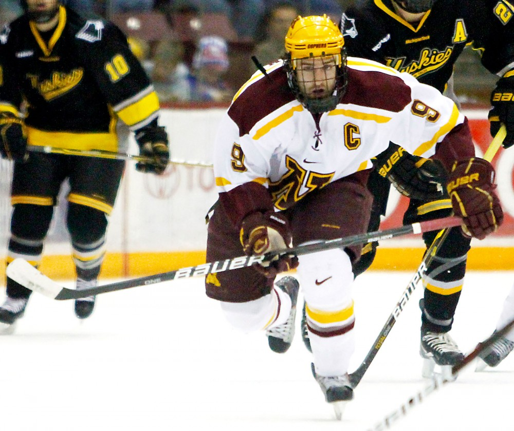 Gophers' forward Taylor Matson chases a puck Dec. 9, 2011 during a game against Michigan Tech at Mariucci Arena.