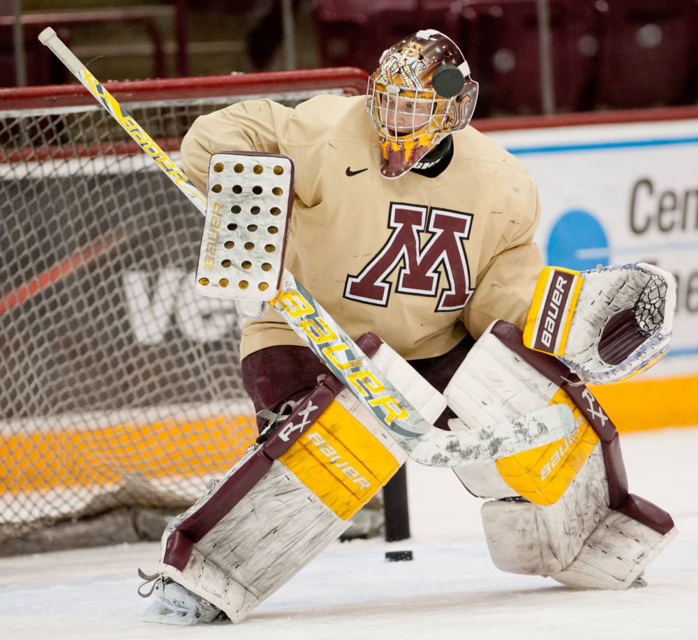 "Backup goalie Jake Kremer practices Monday at Mariucci Arena. ""Basically I just make practice a game for me,"" said Kremer, who has yet to play in a Minnesota uniform."