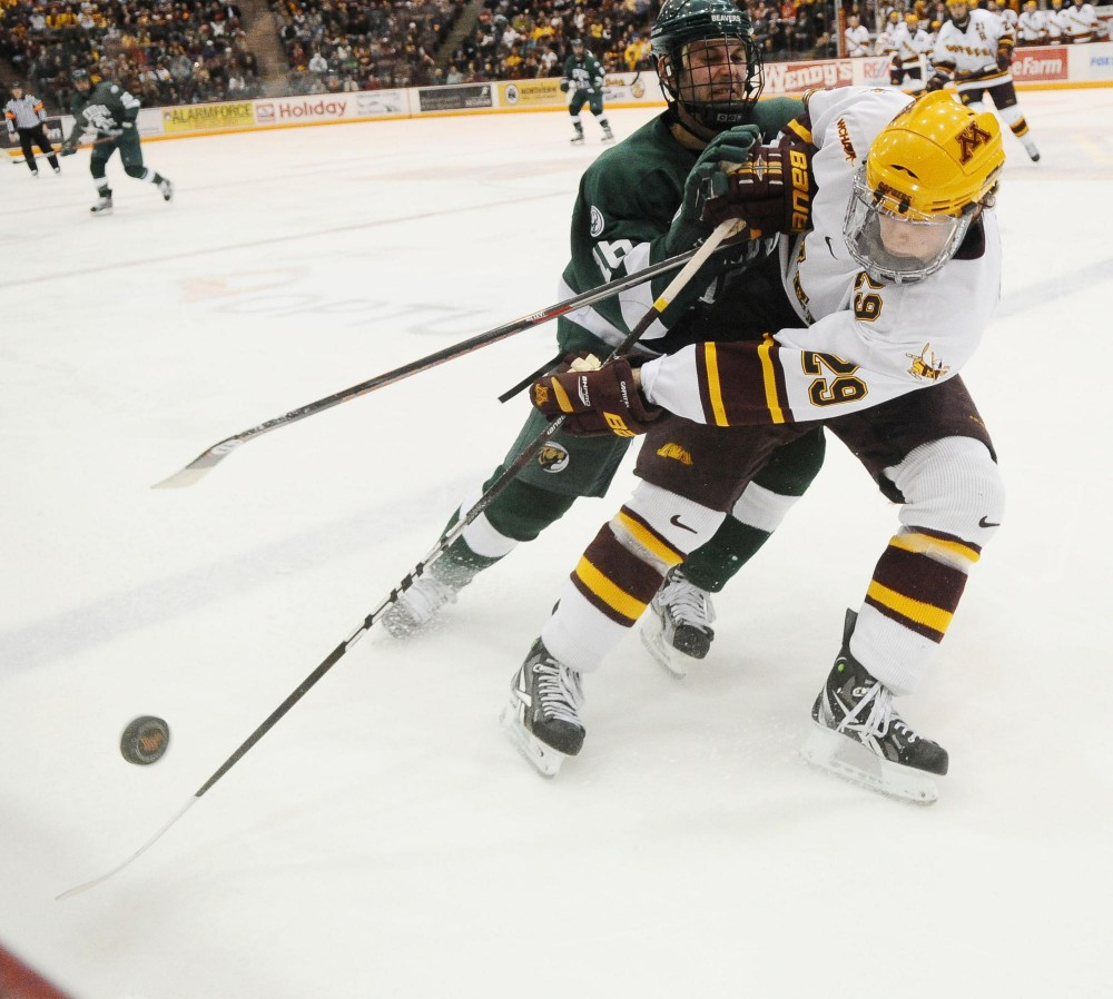 Defenseman Nate Schmidt clears the puck out of the Minnesota zone Saturday night at Mariucci Arena.  The Gophers swept Bemidji State with a 3-0 win Friday night and a 4-1 victory Saturday.