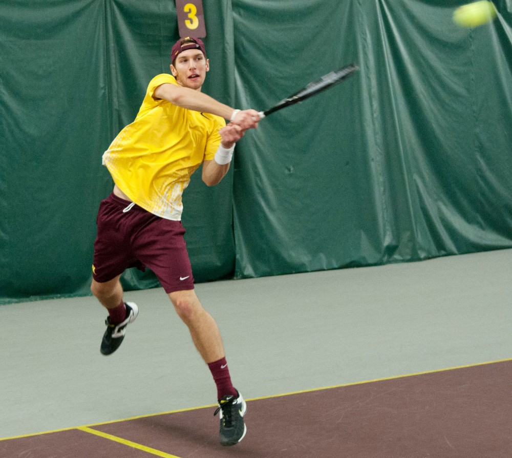 Senior Phillip Arndt returns a hit Saturday during the Men's Tennis team's competition against the Arizona Wildcats.