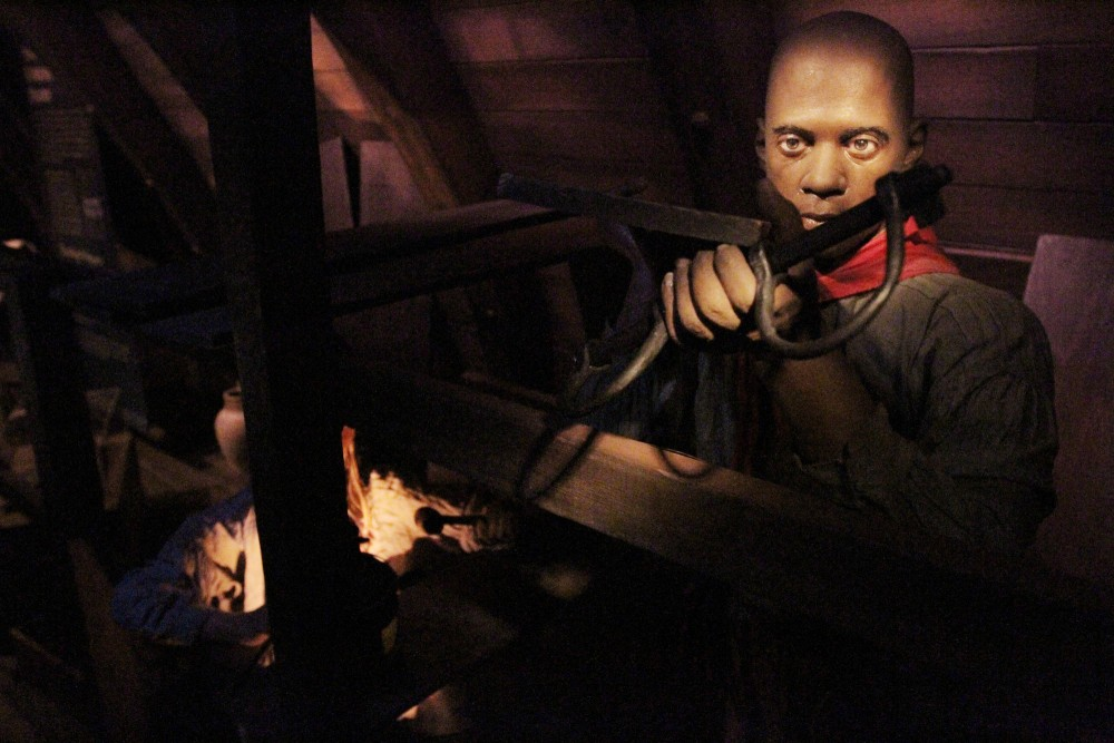 Realistic mannequins of pirates lie within a replica of the 18th century Whydah ship at the Real Pirates exhibit. Many pirates of the ship were former slaves who gained their freedom.