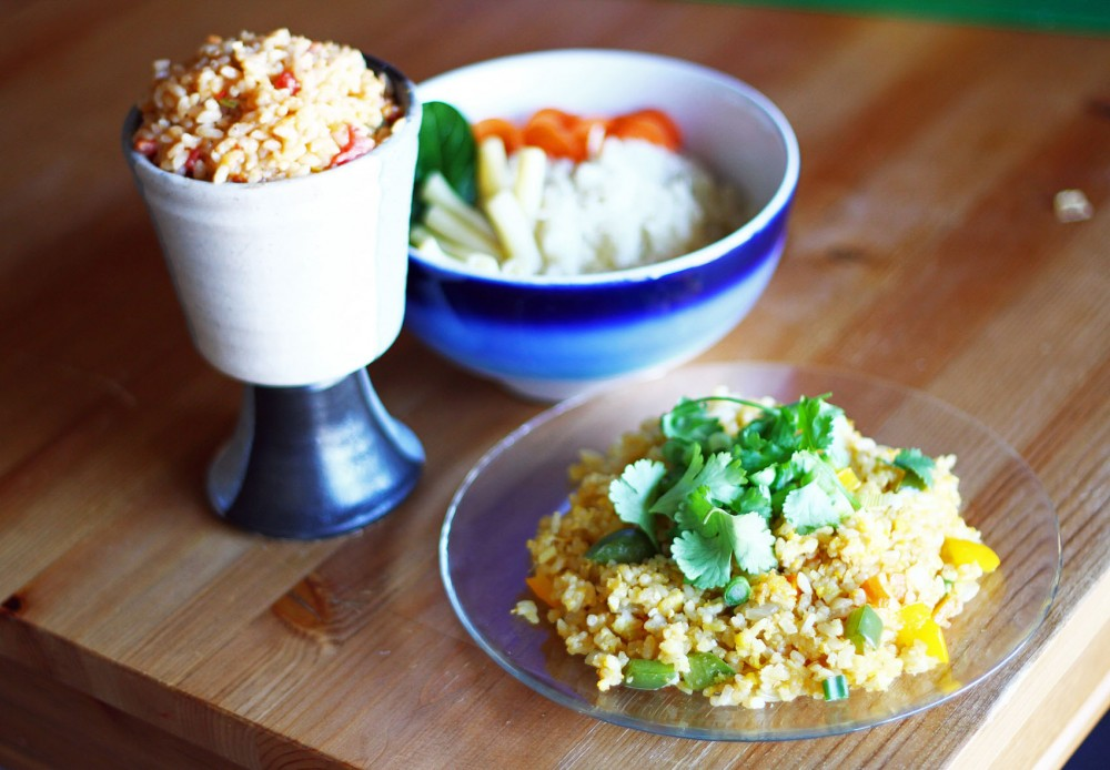 From front to back, fried rice, Thai peanut rice and oven risotto are belly-filling dishes jammed with rich flavors of ginger, garlic, cheese and sake.