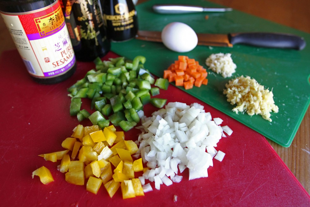 Savory fried rice includes an abundance of ingredients that can include, but arent limited to, green and yellow peppers, onion, carrot, ginger, garlic, egg and soy sauce.