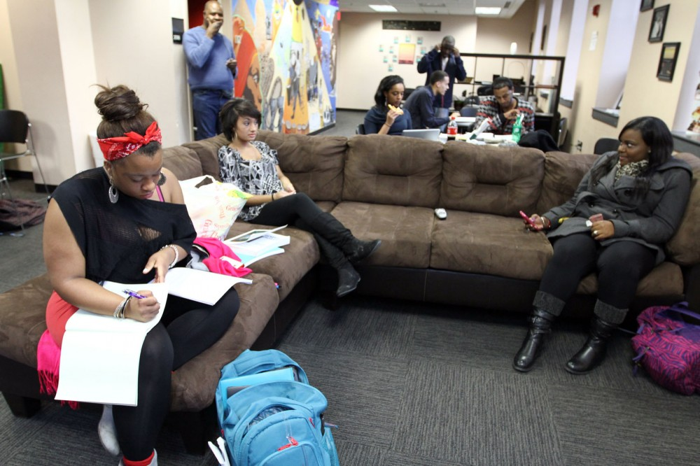 Students from the Black Student Union hang out Monday afternoon in their group's designated space on the second floor of Coffman. Multicultural groups on the second floor are concerned about losing their