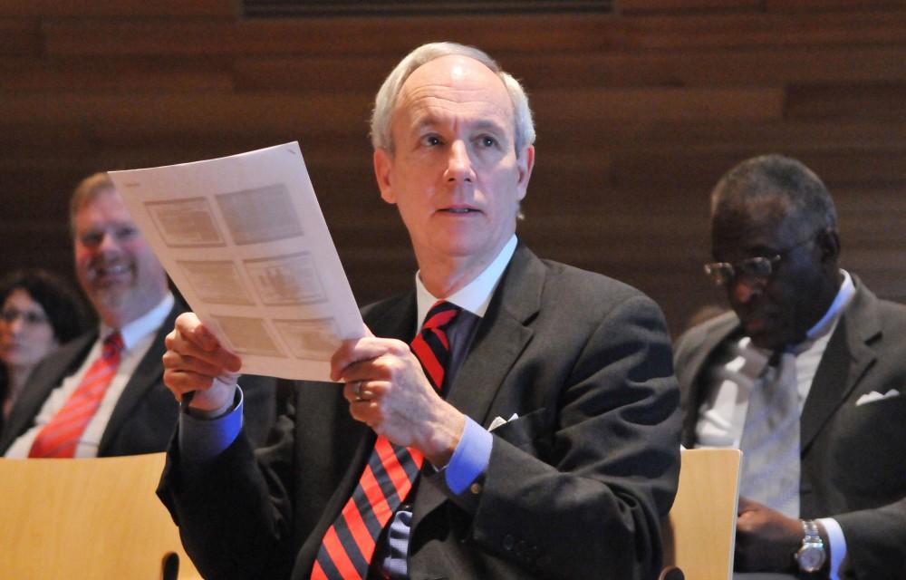 Tom Sullivan listens to a presentation during a Board of Regents meeting Dec. 9 2011 at McNamara Alumni Center.