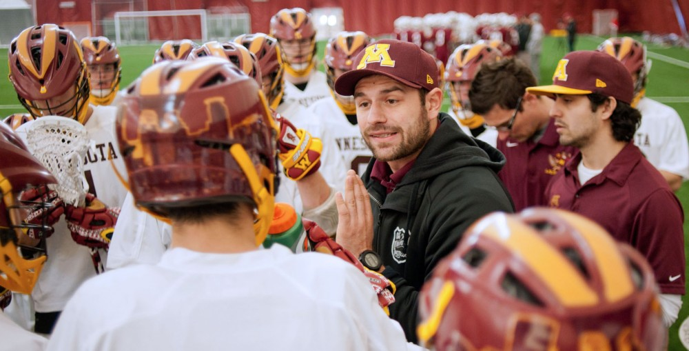 Head coach of the Gophers men's club lacrosse team Joe Cinosky speaks to his players during their game against Duluth on Saturday at the Sports Dome.  Just the night before Cinosky and Gophers assistant coach Aime Caines were in Washington for the Minnesota Swarm's game against the Washington Stealth.