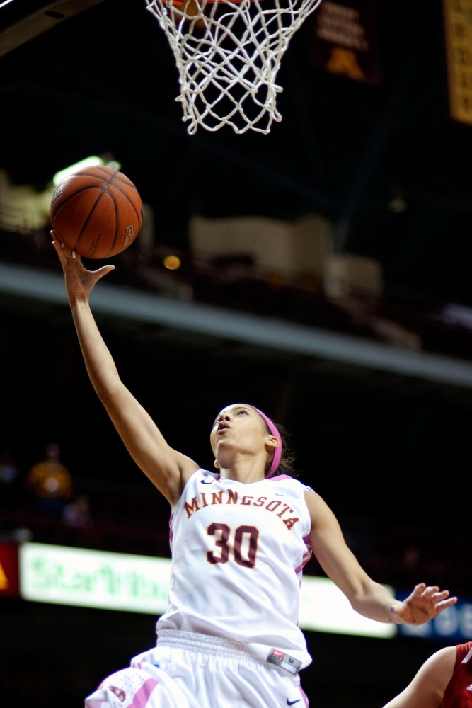 Gophers' senior Kiara Buford drives for two of her 16 points in the Gophers' upset of Nebraska on Monday at Williams Arena.