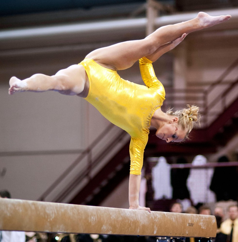 Gophers' sophomore Dusti Russell in action during a balance beam event Saturday at Sports Pavilion.