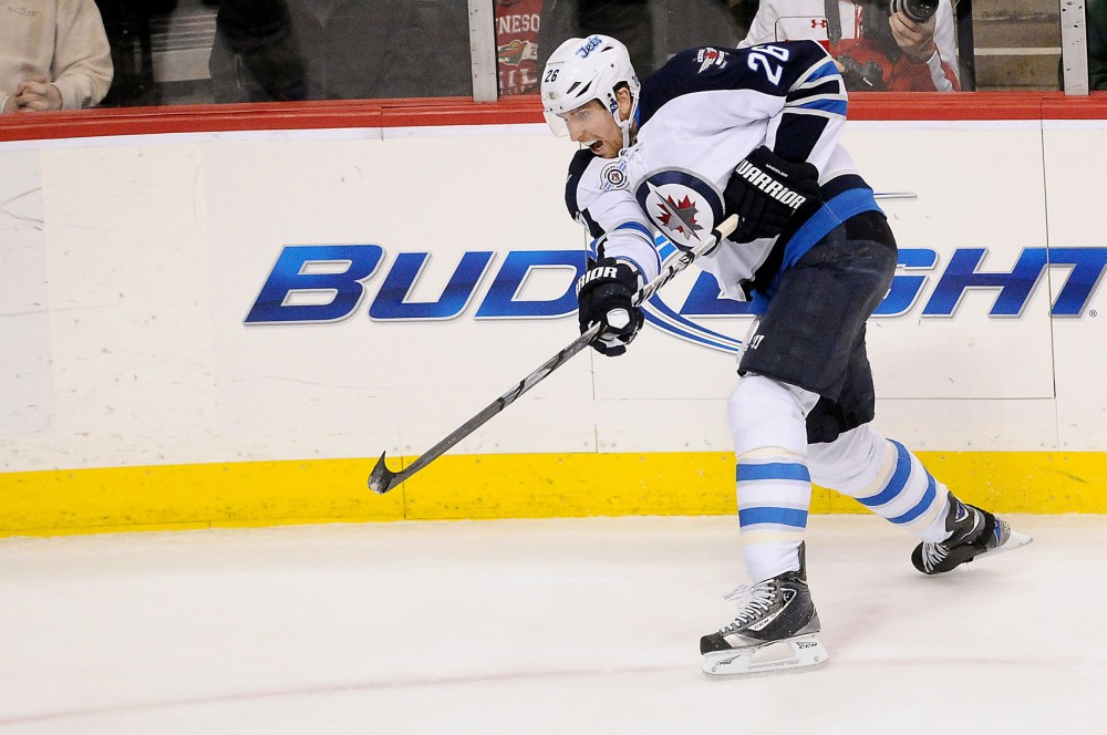 Blake Wheeler, forward for the Winnepeg Jets, takes a shot at the goal during Thursdays game against the Minnesota Wild at the Xcel Energy Center.