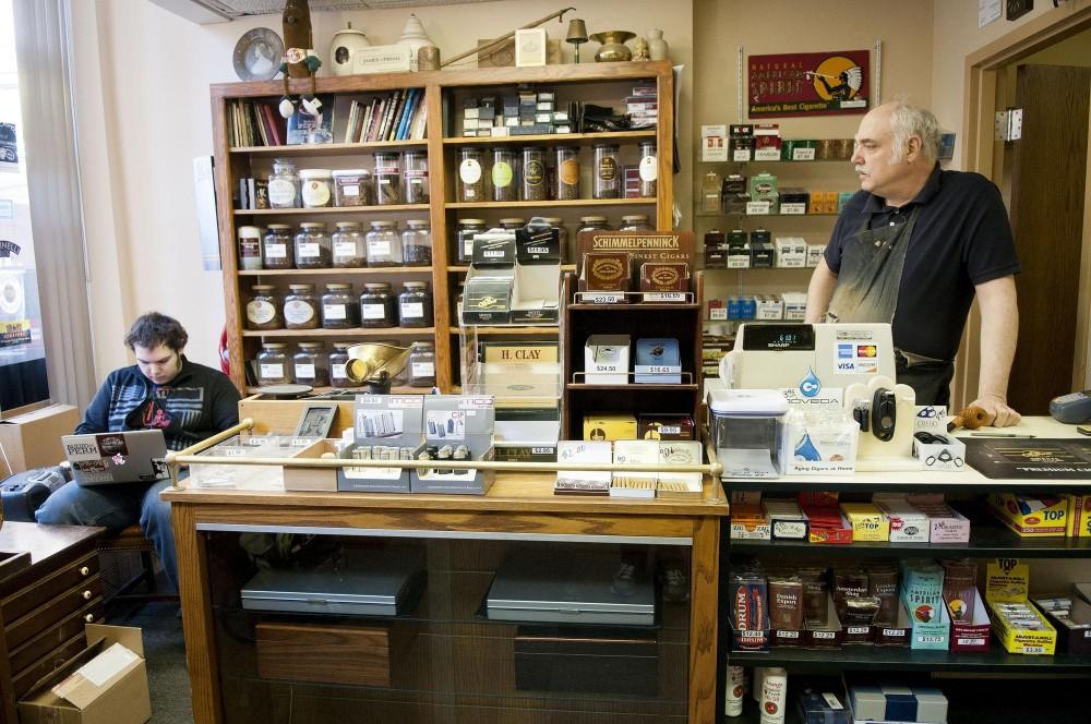 Rich Lewis and his son George work Wednesday afternoon at Lewis Pipe & Tobacco shop.  Lewis has been making pipes for 40 years and has studied the art in both Italy and England.