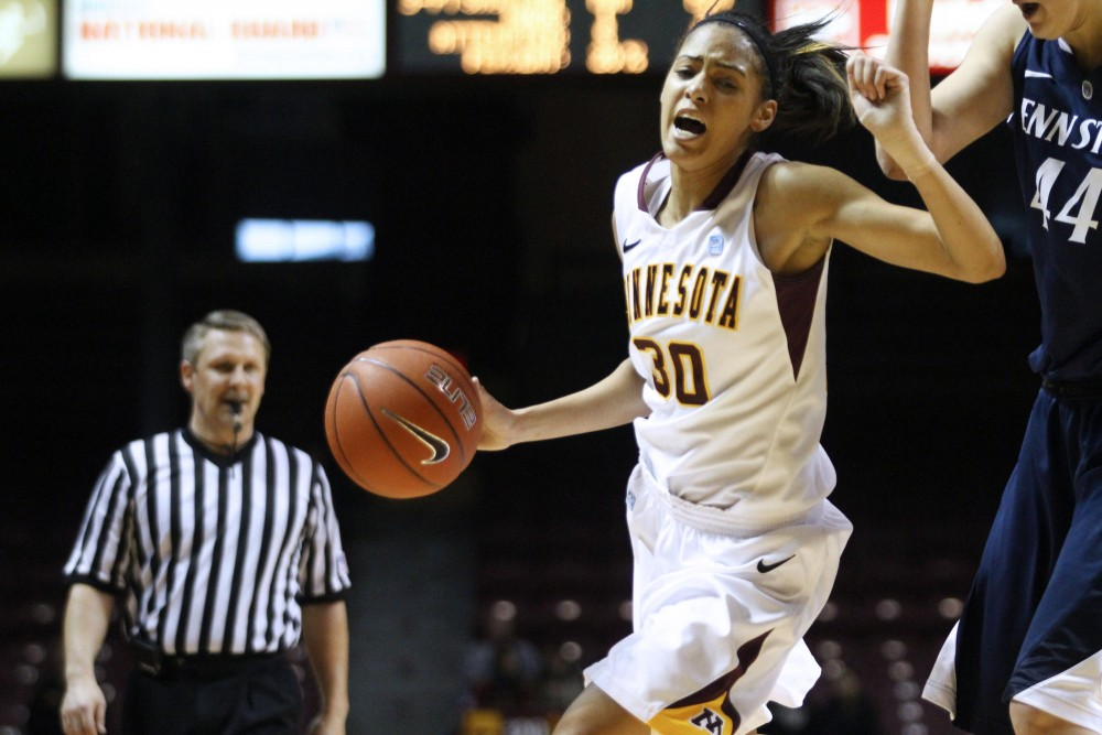 Minnesota guard Kiara Buford charges down the court Sunday at Williams Arena. Minnesota lost to Penn State 68-65.
