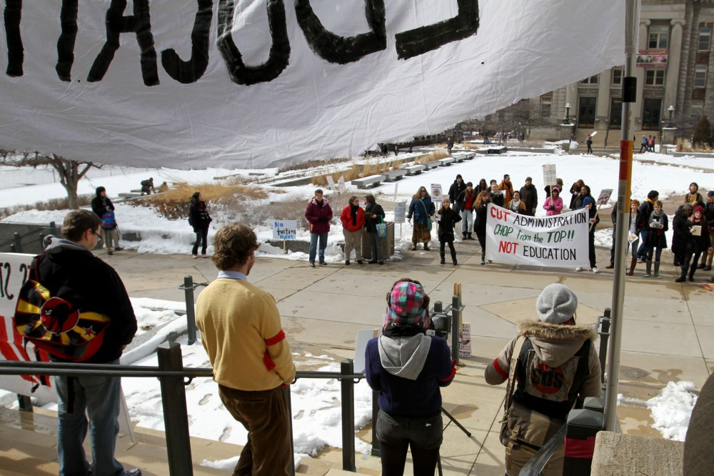 A crowd of about 40 people listen to speakers presented for the National Day of Action for Education Rights on Thursday at Morrill Hall.