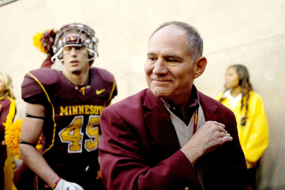 Outgoing Athletic Director Joel Maturi leaves the field after the Gophers' game against Iowa on Oct. 29, 2011 at TCF Bank Stadium.