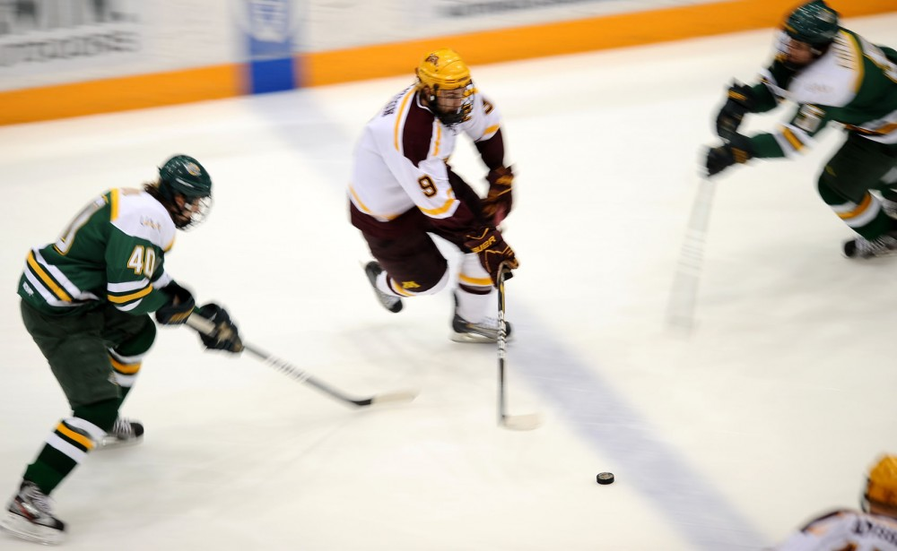 Minnesota defender Jake Parenteau passes during Friday's game against the Seawolves at Mariucci Arena.