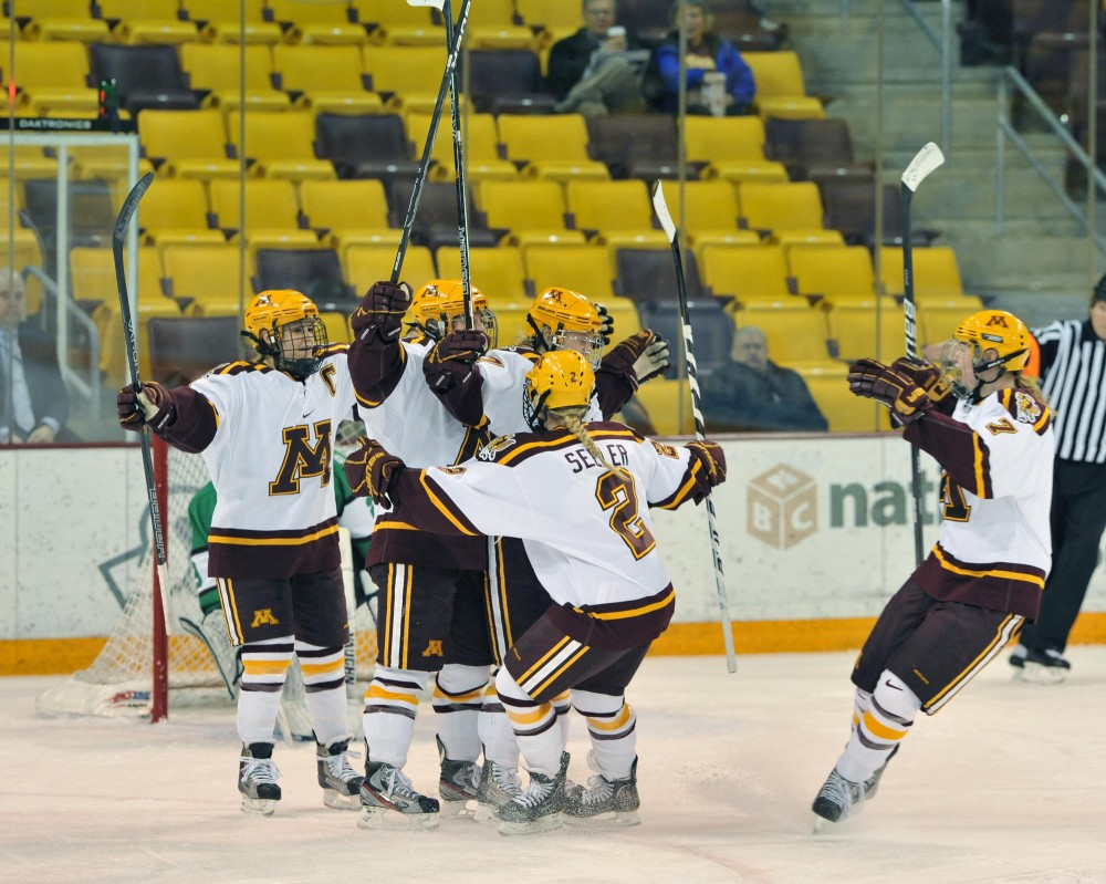 Minnesota scores their first goal against North Dakota on Friday at AMSOIL Arena.