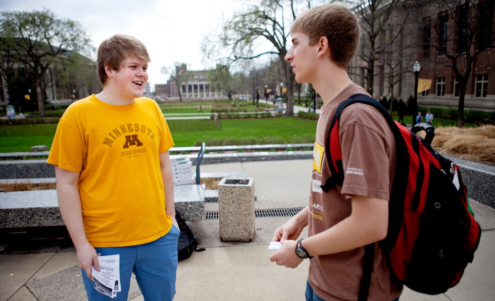 Colter Heirigs, prospective MSA president and University of Minnesota greek member, shares his platform with political science sophomore Mitch Menigo on Friday in front of Northrop Auditorium. Many participating MSA members are also involved in the greek community.