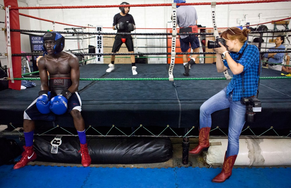 University of Minnesota alumna Becky Olstad photographs Circle of Discipline member 21-year-old Puol Both Tuesday evening at ringside. Both is a youth mentor at Circle of Discipline and has made it into the 2012 Olympic trials.