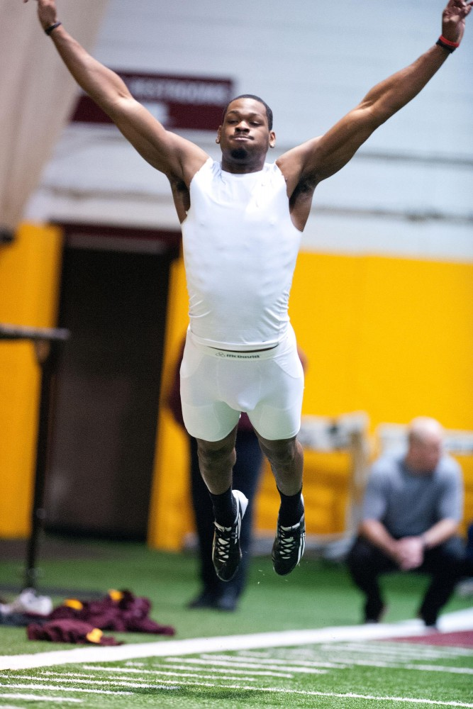 Da'Jon McKnight  participates in the broad jump at Minnesota's Pro Day. McKnight worked out in front of a number of NFL scouts Monday at Gibson-Nagurski Football Complex.