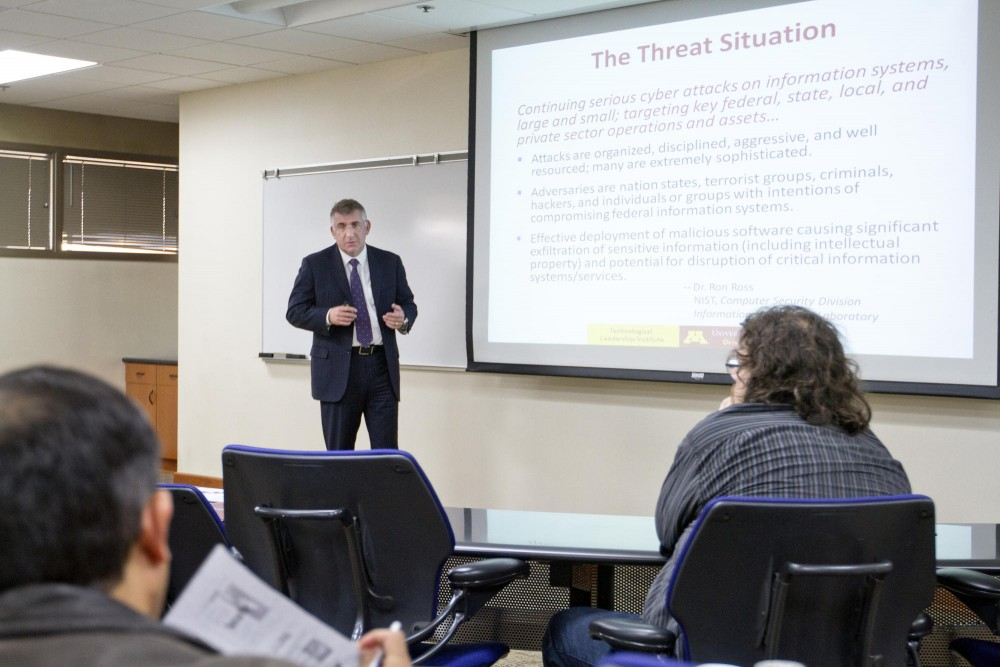 Prospective students are briefed on cyber threats and security issues facing the technology industry on Tuesday at the West Bank Office Building.