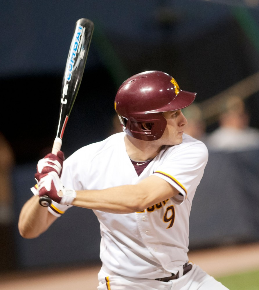 Gophers shortstop Michael Handel bats during a game on Tuesday at the Metrodome.  The game resulted in a Gopher loss of 7-0 against North Dakota State University.