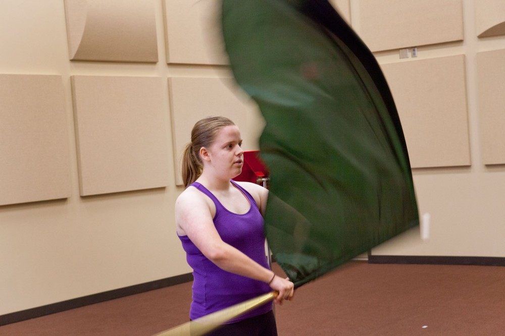 Sophomore Magee Glenn-Burns auditions for the color guard section leader position in the University of Minnesota Marching Band.