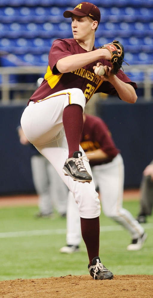 DJ Snelten pitches during Saturday evening's game against The Citadel at the Metrodome.  The Gophers had a shutout victory with a score of 3-0.