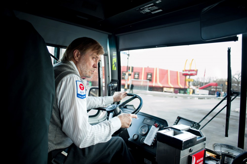 Wayne Adermann drives his route 3 bus through Dinkytown on Thursday. Adermann, 64, has been