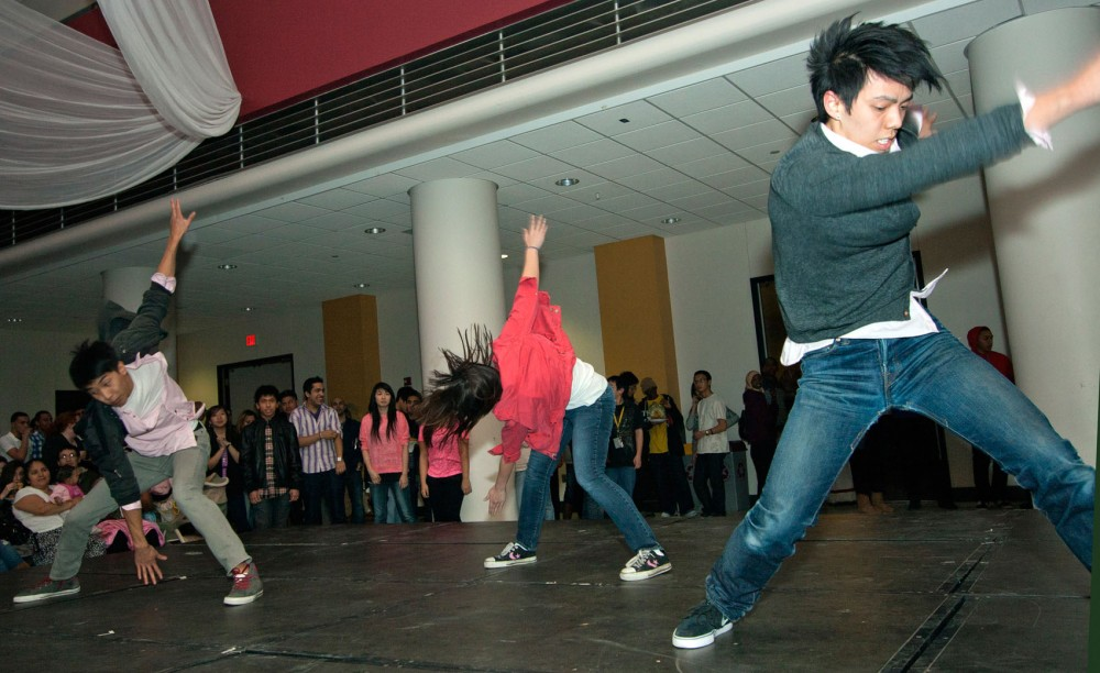 The Chinese American Student Association performs a dance routine Friday in the Great Hall of Coffman Union.