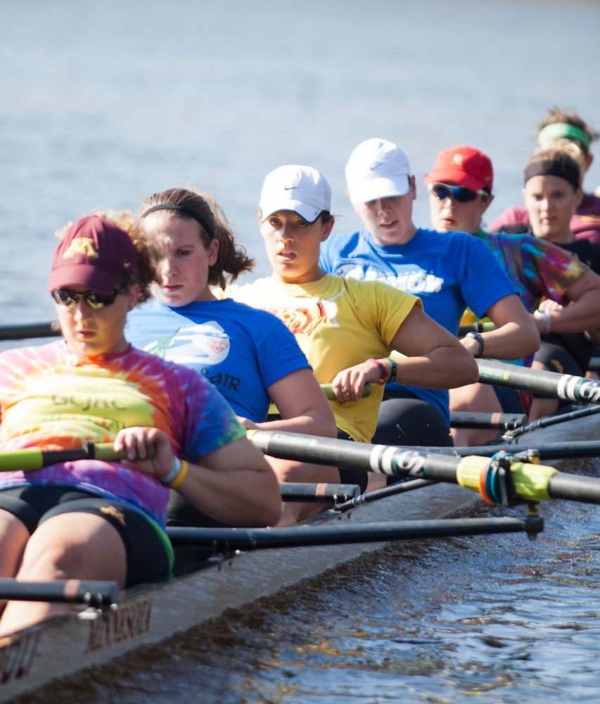 Katherine Windsor, 3rd from front, rows during practice with the varsity team Wednesday afternoon on the Mississippi River.  Windsor rowed for the novice team during 2010-11 season.