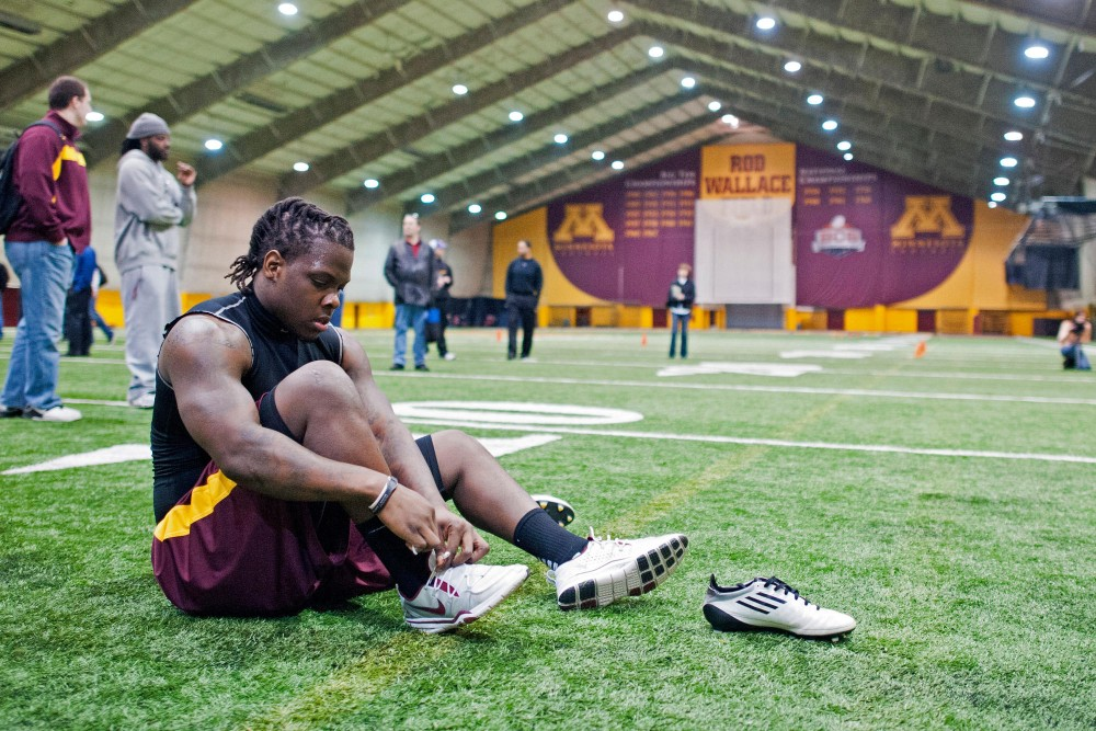 Former Gophers linebacker Gary Tinsley prepares for the next test at Minnesota's Pro Day on Monday at the Gibson/Nagurski Football Complex. Eight players from the Gophers' 2011 football team went through a series of drills and measurements in front of NFL scouts.