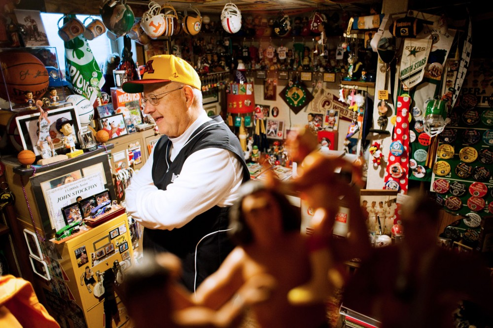 Dick Jonckowski stands amid his massive sports memorabilia collection Monday in the basement of his Shakopee, Minn., home.  Jonckowski is the public address announcer for Gophers men's basketball and baseball.