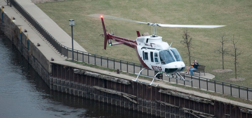 A Minnesota State Patrol helicopter searches the Mississippi River on Tuesday evening after a man jumped from the the I-35W bridge.