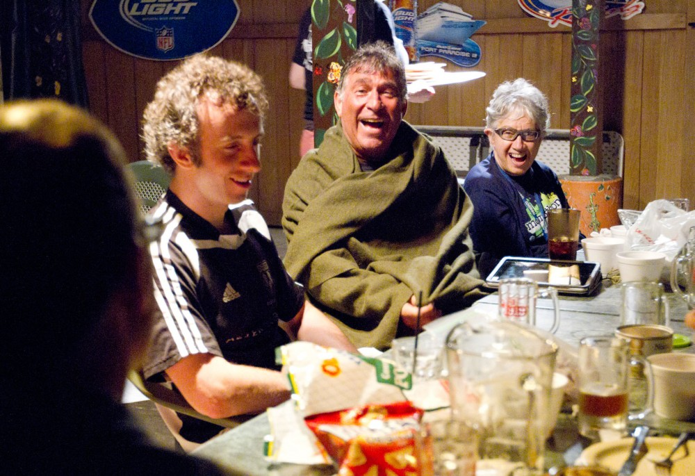 Rep. Phyllis Kahn shares beer and pizza with members of her hockey team, the Golden Seahorses, on Sunday night at Skinners Pub and Eatery in Saint Paul, Minn.