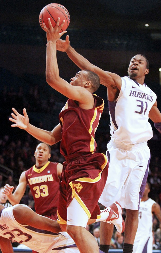 Minnesota guard Andre Hollins came up big in the second half andthe overtime period Tuesday in the Gophers' overtime win overWashington at Madison Square Garden.