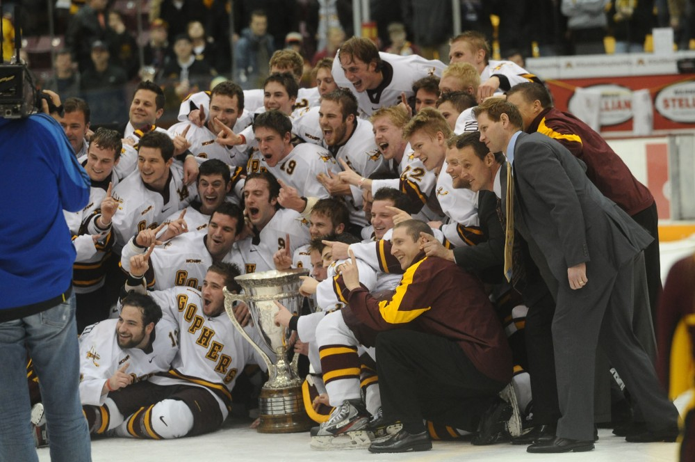 Minnesota celebrates its MacNaughton Cup title after a 2-1 victory over Wisconsin Saturday night at Mariucci Arena.  The Gophers haven't won the league title since 2007.