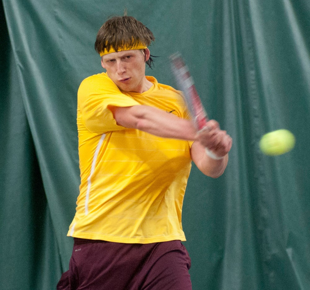Minnesota's Leandro Toledo returns a hit from his Michigan State opponent during a match on Friday at the Baseline Tennis Center.  The Gophers swept Michigan State 7-0 to win their sixth consecutive match.