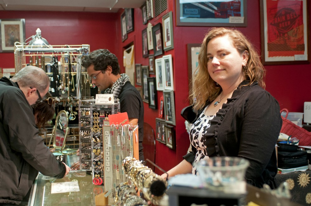 Sarah Cura, owner of the Sara Cura shop in Dinkytown, pauses before assisting customers on Saturday.  After 5 years in Dinkytown, Sara Cura will close its doors on April 8.