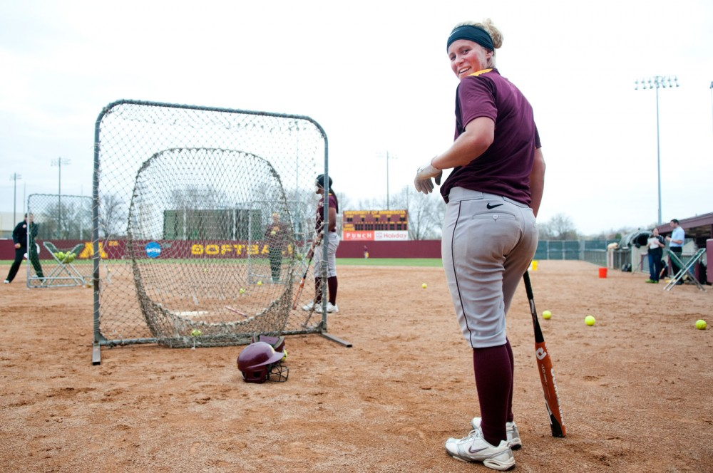 Gophers senior Dannie Skrove practices with her team Tuesday afternoon at Jane Sage Cowles Stadium. Skrove is recovering from a broken hand she suffered during practice in January.