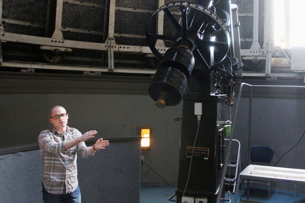 Skyler Grammer, an atstrophysics graduate student, describes the process of modernizing the more than 100-year-old Tate observatory telescope. The telescope is estimated to weigh 500 pounds and is mostly used to view planets and galaxies.