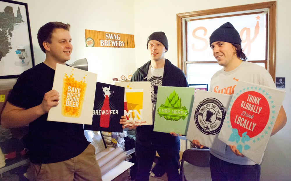 Creative Director Colin McSteen, Web Director Brett Bartley, and Business Director Maxwell Arndt showcase art prints from their new business called