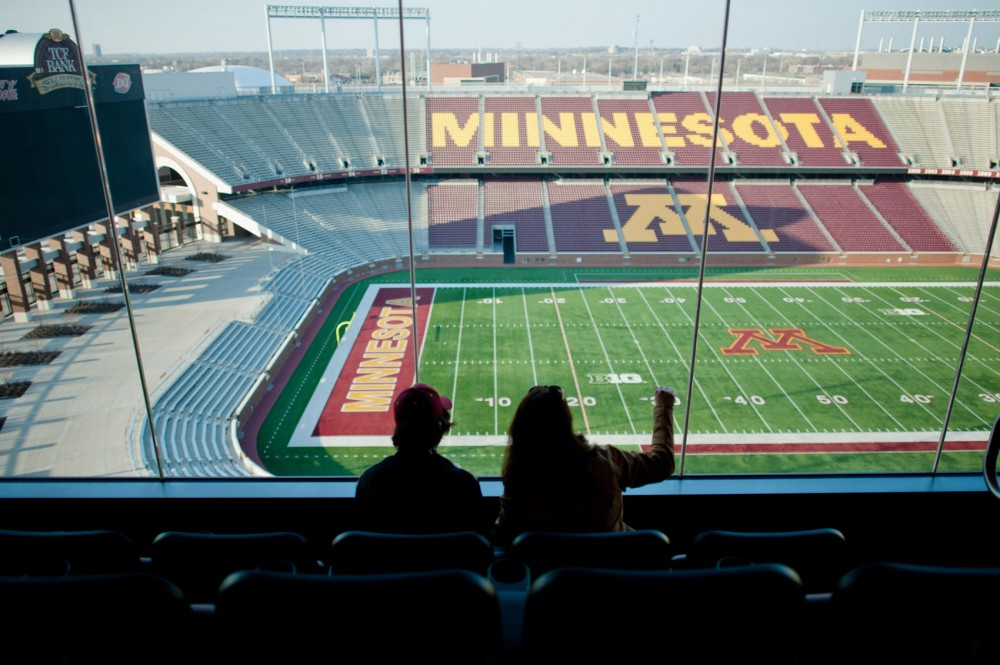 Guests at a CSE recruitment event enjoy the view from the Indoor Club room on March 14 at TCF Bank Stadium.