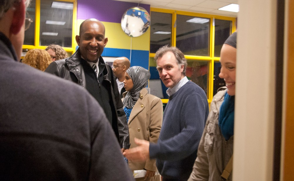 Councilman Cam Gordan greets attendees after the informational meeting he hosted Tuesday night at the Brian Coyle Center.  The meeting focused on tenant's rights with residents of Riverside Plaza.