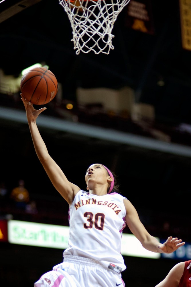 Gophers senior Kiara Buford drives for two of her 16 points in the Gophers' upset of Nebraska Feb. 13 at Williams Arena.