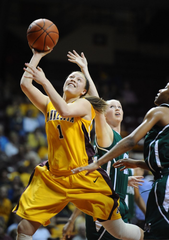 Gophers guard Rachel Banham goes up for a basket against Manhattan on Friday at Williams Arena.