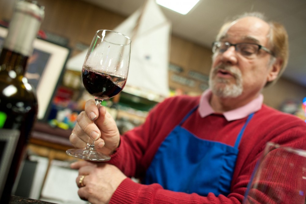 Wine buyer Michael Hennessy performs a proper wine tasting method Friday at McDonald's Liquor and Wine in Minneapolis.