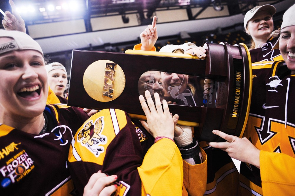 The Gophers womens hockey team celebrates in front of fans after winning the NCAA Frozen Four championship on Sunday in Dulith, Minn.  Minnesota defeated Wisconsin 4-2.