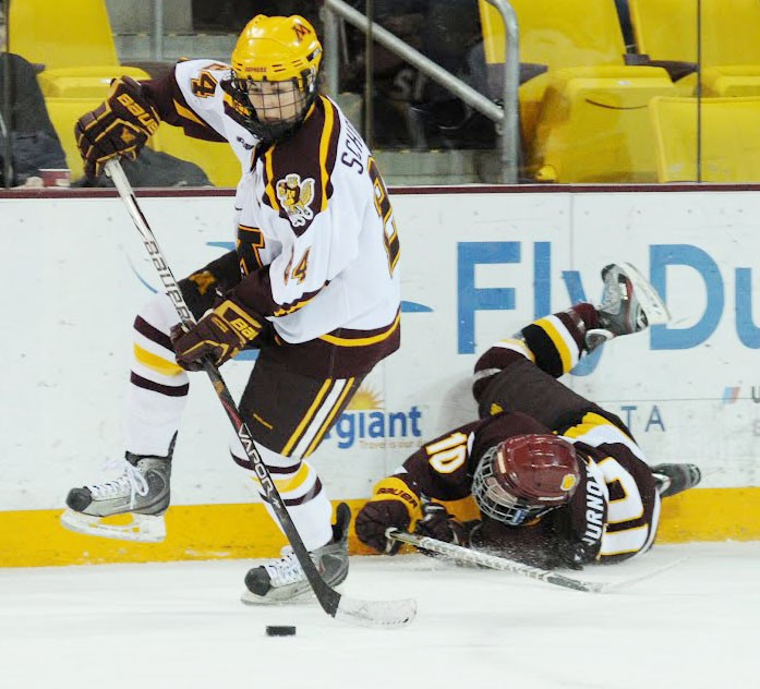 Minnesota center Jen Schoullis controls the puck against Minnesota-Duluth in Saturday's WCHA championship game at AMSOIL Arena.